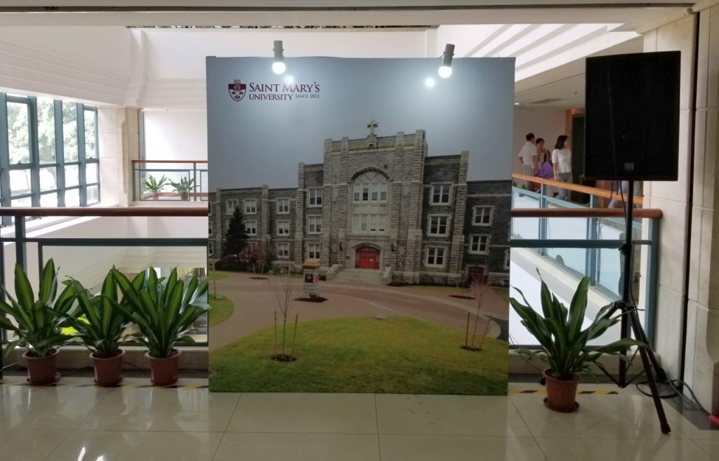 A photo of the front entrance of our alma mater was displayed at the entrance of the hallway leading to the reception.